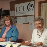 Women working in Echo re-sale shop of fine women's clothing and accessories